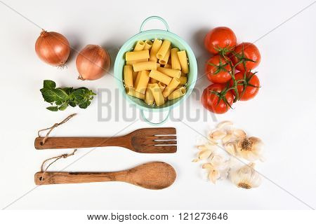 Top view of the ingredients for an Italian meal on white.