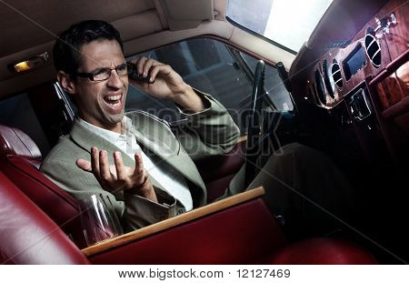 Elegant man in the car calling