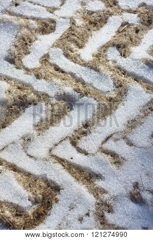 old wheel tracks on snow