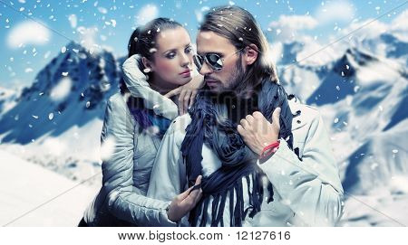 Fashionable couple posing over alpine mountains