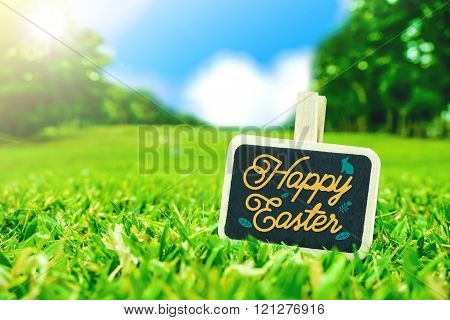 Happy Easter On Clip Board On Green Grass Field With Blur Park Background,holiday Season