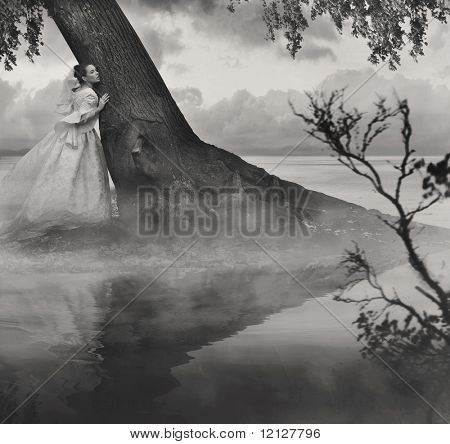 Fine art photo of a woman in beauty scenery in black and white
