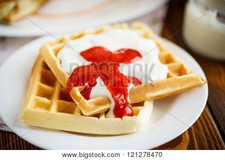 Viennese waffles with yogurt and strawberry jam