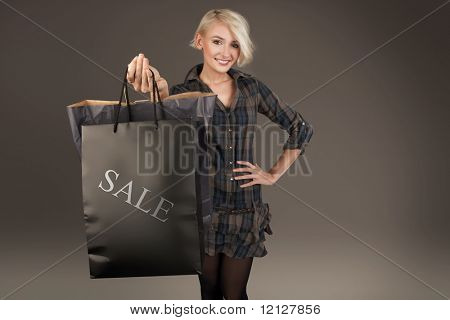 Young lady with shopping bag