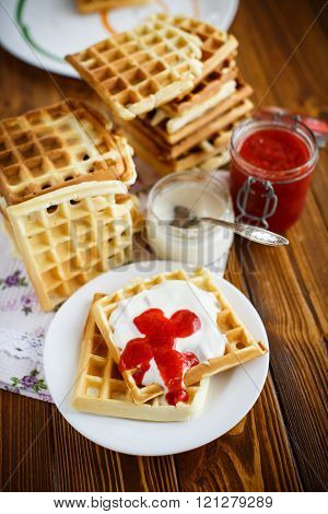 Viennese waffles with yogurt and strawberry jam