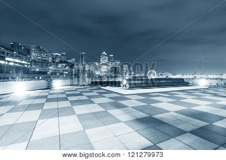 marble floor with cityscape of seattle at night