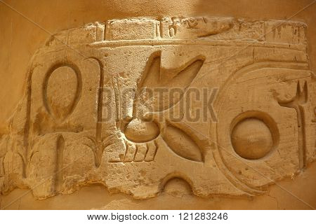 Ancient Egyptian hieroglyphs carved on the stone.