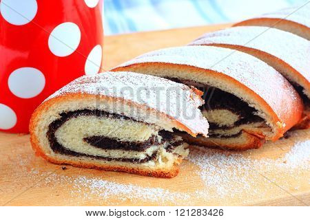 Poppy Seed Strudel And Red Cup With White Polka Dots