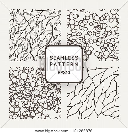 Set of vector seamless patterns in the style of veining or cracks and chaotic circles.