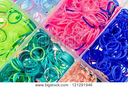 Multi-colored elastic bands in a box. Background