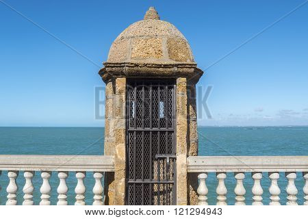 Old watchtower on the promenade of Cadiz Genoves Park Andalucia Spain. Sea Sunny day and nice sky.