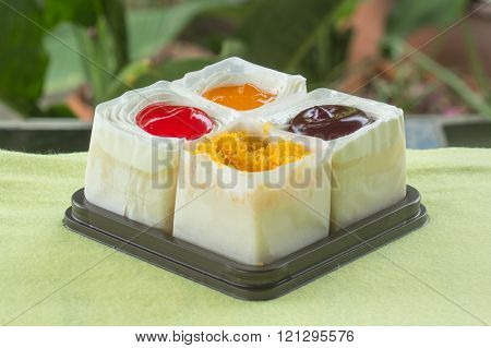 Strawberry Blueberry Orange and slice sweet egg mini cake on the box