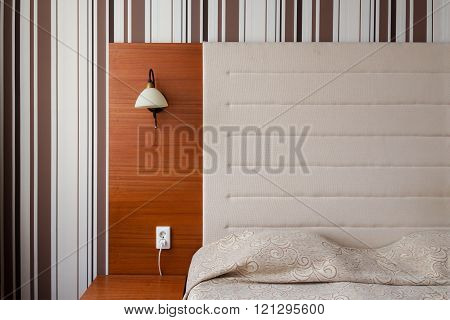 Headboard and bed in a clean hotel room