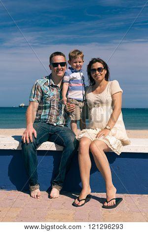 Happy family enjoying sunny day on the coast in Spain