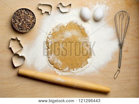 Dough with rolling pin on the wooden table. Kitchen background