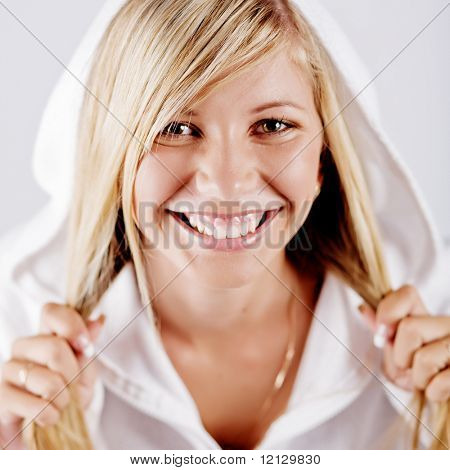 Happy blond girl laughing in white hoodie