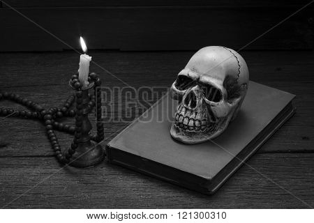 Still Life Photography  With Human Skull And Mala On Wood Background.