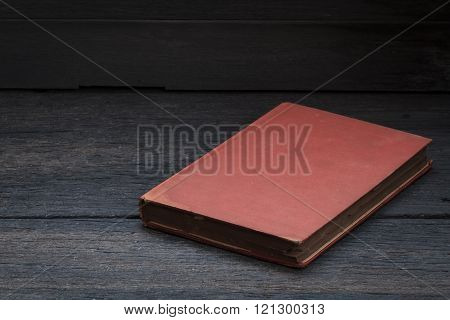 Still Life Photography  With Old Red Book On Wood Background.