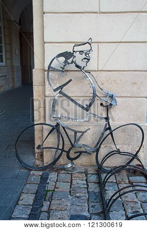 Lviv, Ukraine - October 18, 2015: Parking for bicycle with forged metal known literary character - S