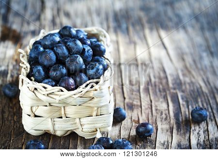 Fresh Blueberries In Basket Om Wooden Background