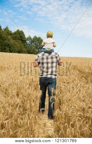 man walking with his kid in the field