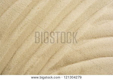 closeup of sand pattern on a beach in the summer