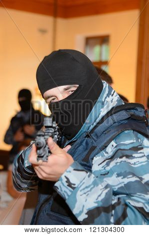 Petersburg, Russia, august 8, 2014: cafe Arnold, show actors. Militant special forces. Capture of the terrorists. Warrior caught the criminal. Soldier in uniform with a gun.  Fighter in the mask.