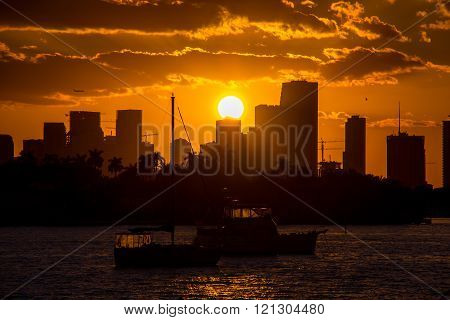 Sunset time. Looking Miami Skyline from Miami Beach