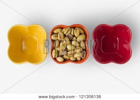Pistachio Nuts On Colorful Bowls