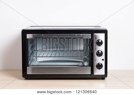 small electric oven isolated in the kitchen