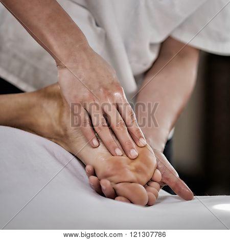 Massaging Foot