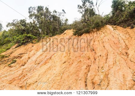 Slope erosion with earth collapse at in tropical climate environment after heavy rain fall