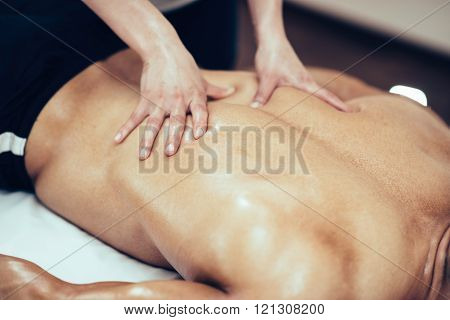Physical Therapist Massaging Back