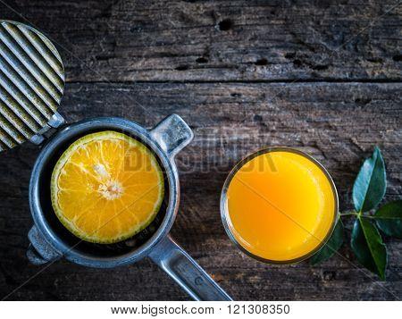 Still Life Orange Juicer With Orange Juice.
