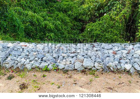 Slope Earth Retention Wall With Rocks And Wire Mesh Cage