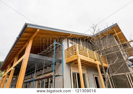 Scaffolding at the construction site of a new wooden house