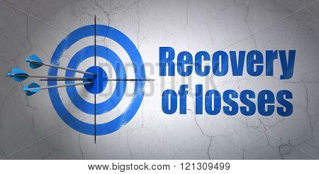 Money concept: target and Recovery Of losses on wall background