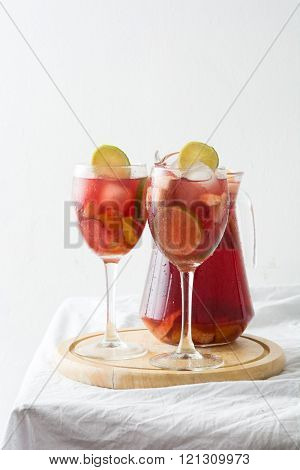 Homemade fresh summer sangria on tablecloth