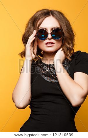 amazing woman wear black outfit,fashionable. Large Blue Round Sunglasses.