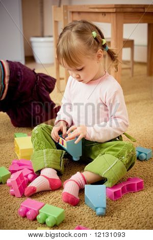 Casual shot if child in room playing with toys