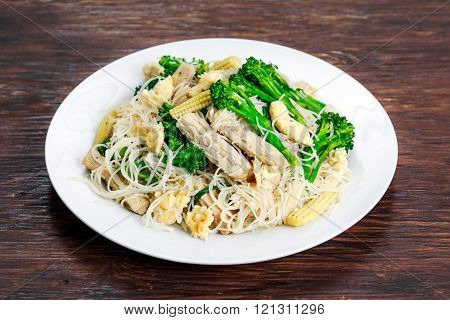 Fried Rice Noodles with Pork and brocoli