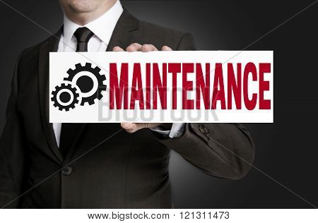 maintenance only sign is held by businessman