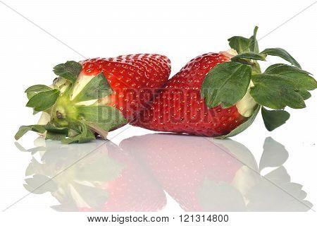 Duo of strawberries reflected on the floor huelva