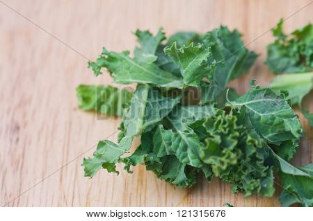 Fresh super food kale on a wooden chopping board