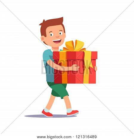 Cute boy holding big ribbon bow wrapped gift box