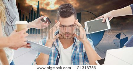 Tensed businessman with head in hand against blue data