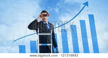 Businessman looking on a ladder against blue data