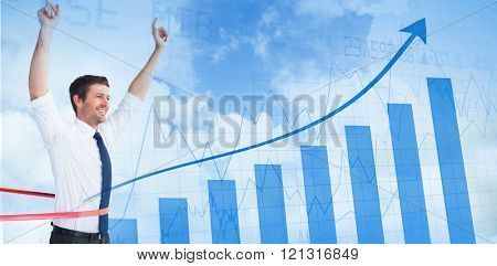 Businessman crossing the finish line against blue data