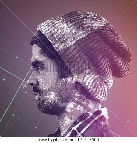 Profile view of confident hipster against grey matrix