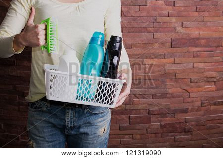 Woman Holding Basket With Detergents